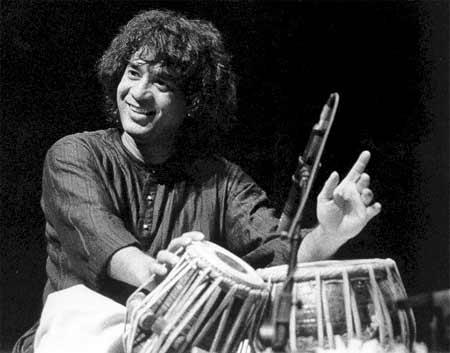 http://www.drummerworld.com/pics/drum12/zakir_hussain2.jpg